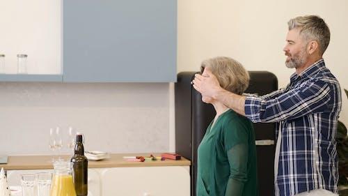 Husband Close her Wife Eyes
