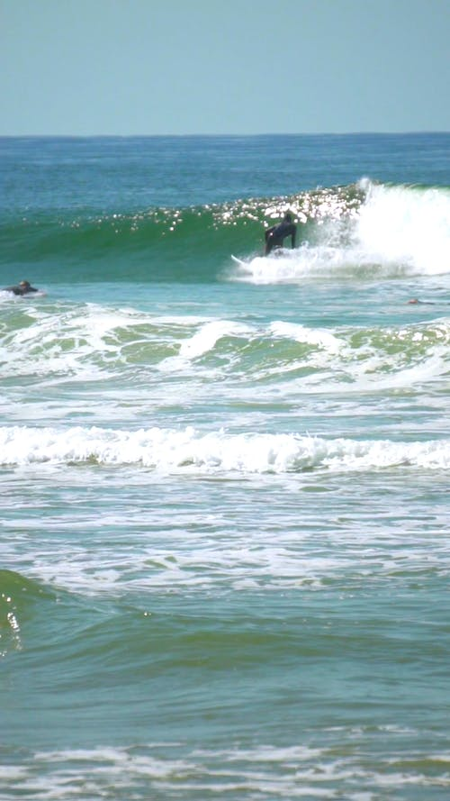 Slow Motion Video of a Man Surfing