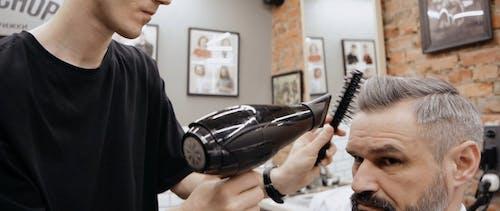 Man having Haircut on the Barbershop