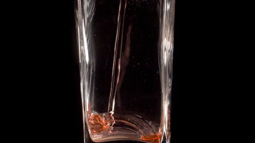 Pouring a Red Juice in a Glass