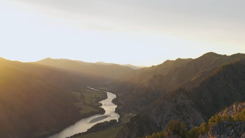 An Aerial Footage of a River between Mountains
