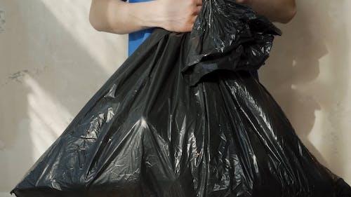 Volunteer with a Trash Bag