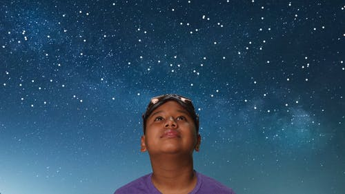 Boy Looking Up at the Stars