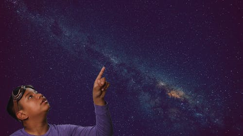 Boy Pointing Up at the Stars