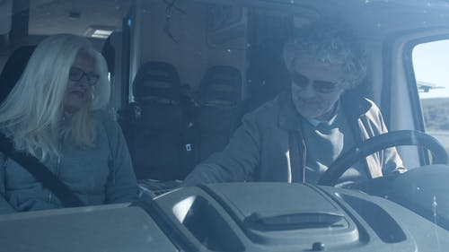 An Elderly Couple Sitting Inside a Vehicle