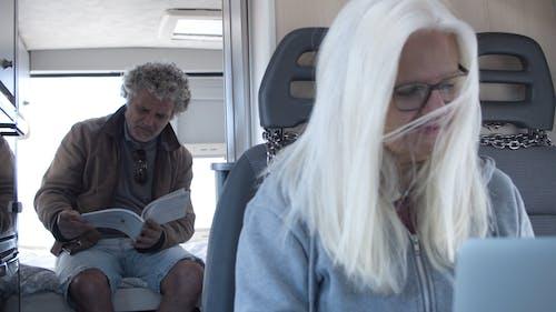 Couple Sitting Inside the Caravan