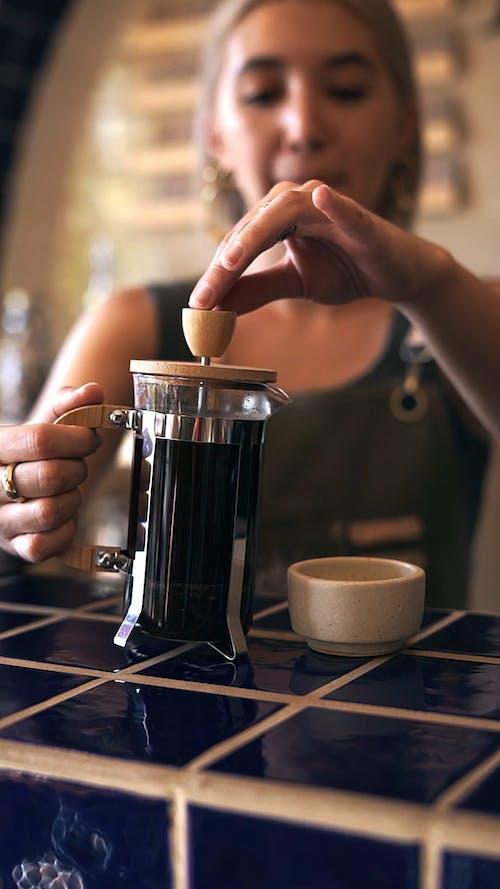 Video of Barista Putting Fresh Brewed Coffee on Ceramic Mug