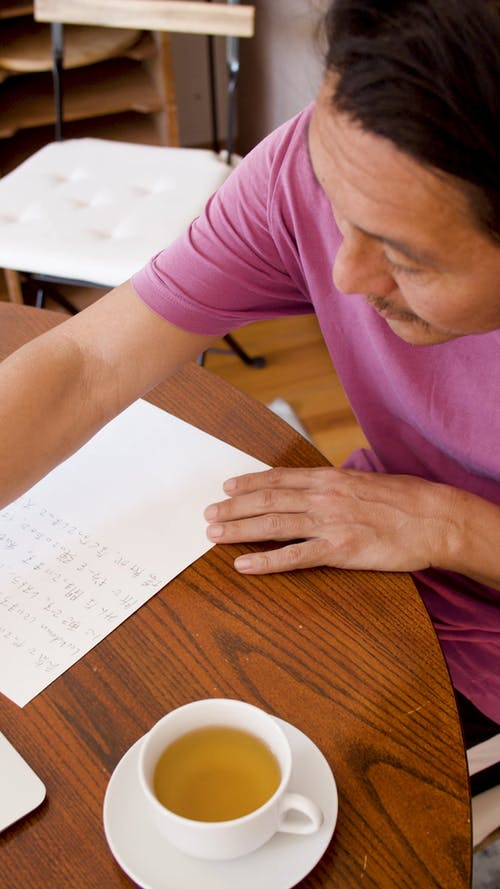A Man Writing on Paper