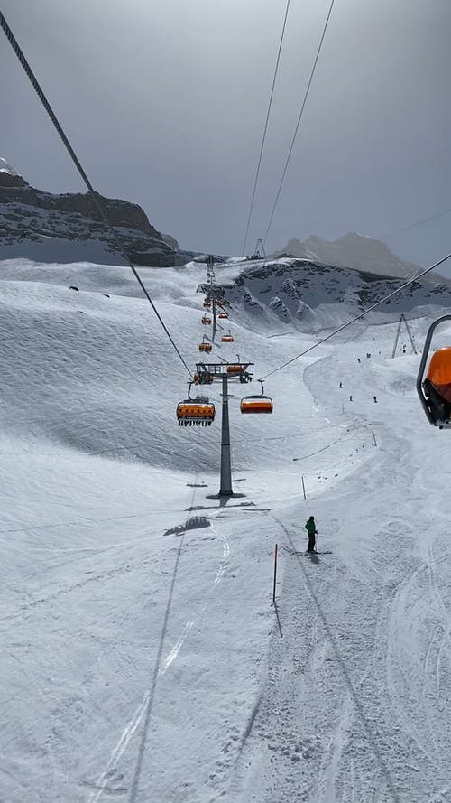 A Ski Lift Going Up to the Snowy Mountain
