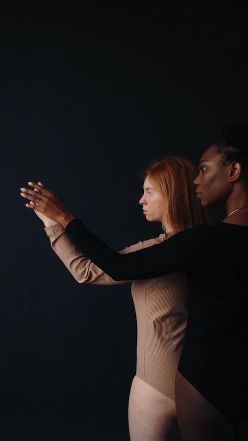 Female Models Holding Hands