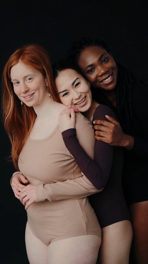 Women Hugging Each Other from the Back
