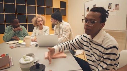 People Brainstorming at a Meeting