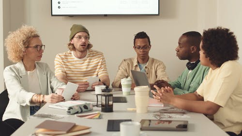 People Having a Discussion at a Meeting