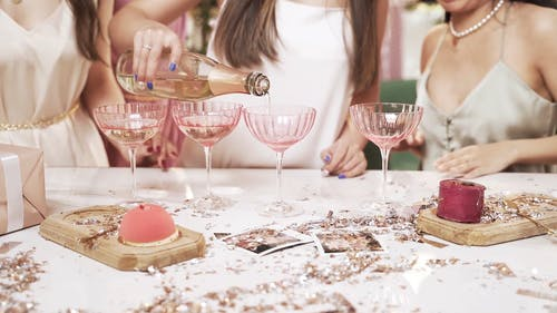 Pouring Wine on Cocktail Glasses