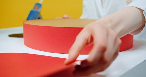 Covering Cardboards With Red Paper
