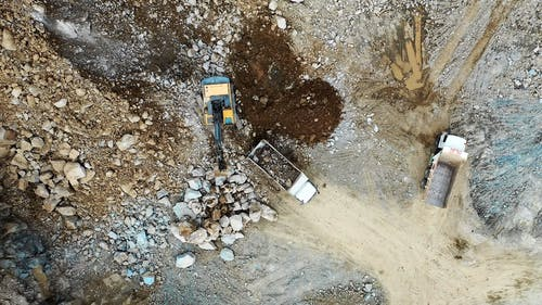 Aerial Footage of Trucks on a Construction Site
