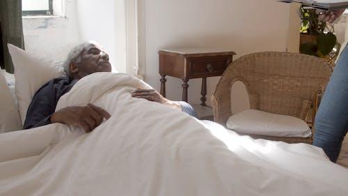 Nurse Checking the Elderly Man's Pulse Rate