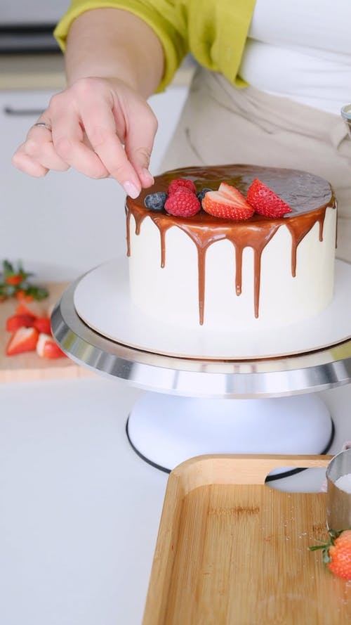 A Person Decorating a Cake