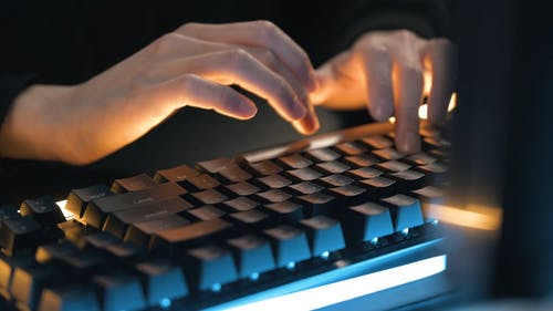 Person using Keyboard while Typing