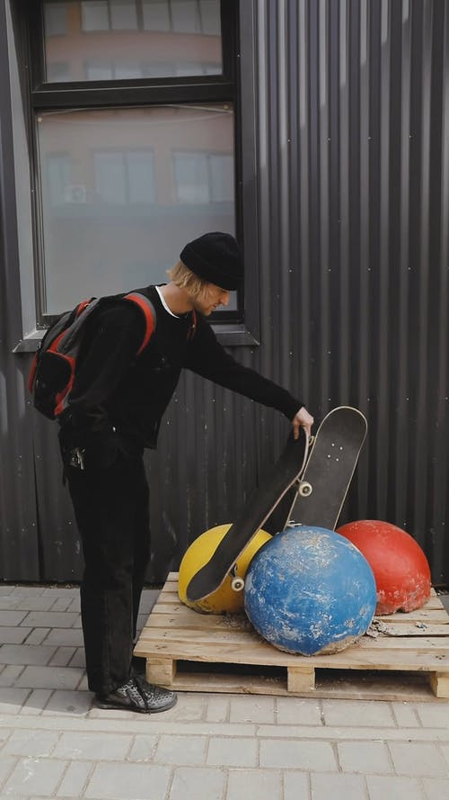 Man Balancing Skateboard on Round Object