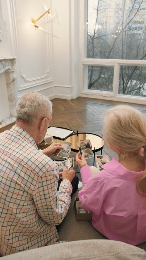 Elderly Couple Looking at Old Photos