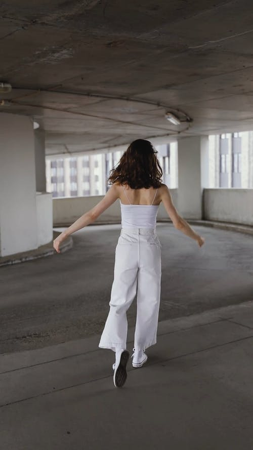 Female Dancing in a Parking Area