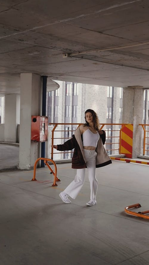 Female Dancing in an Abandoned Parking Garage