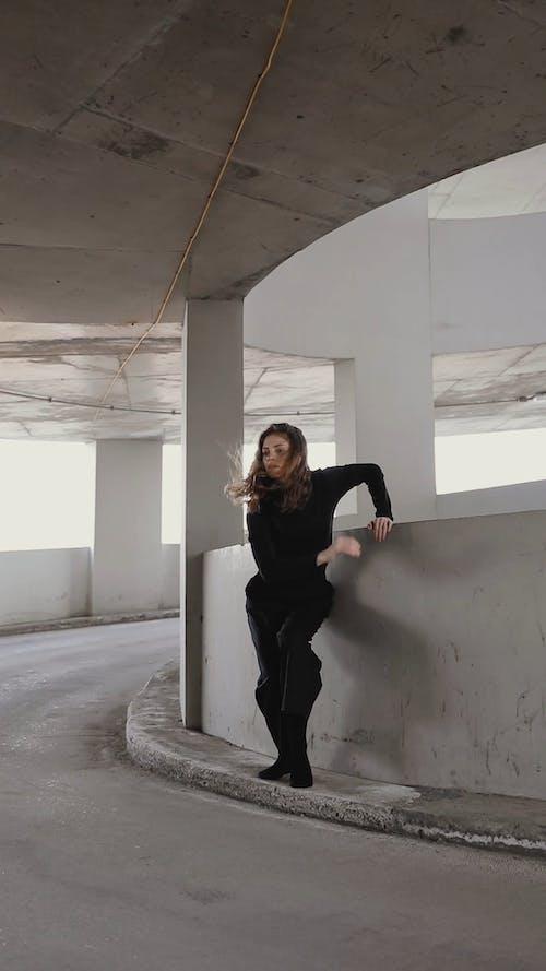 A Woman in Black Dancing