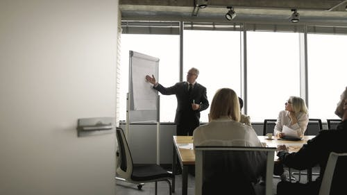 Man Presenting on a Meeting