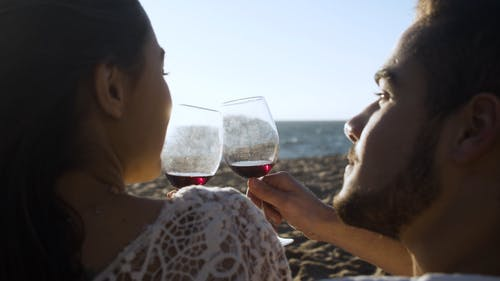 Couple Drinking Wine on a Beach