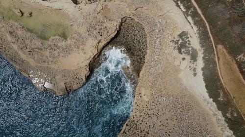 Sea Waves Crashing Through a Rocky Shore