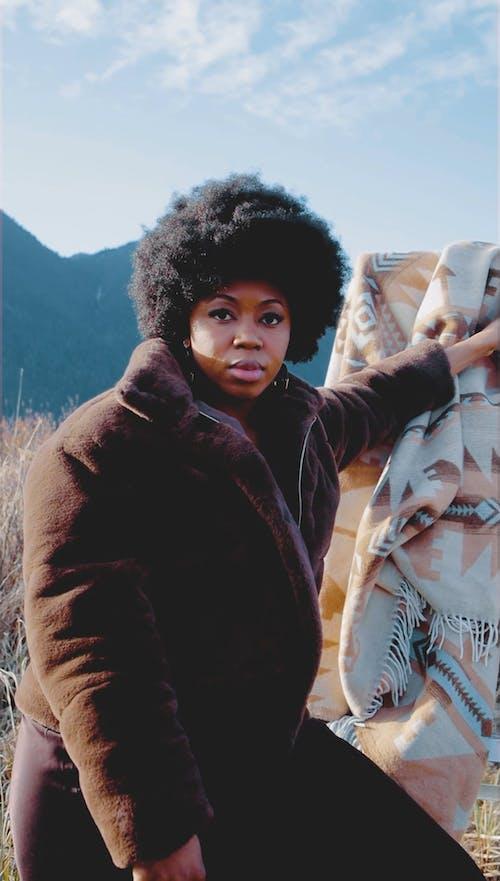 An Afro Woman Wearing Jacket