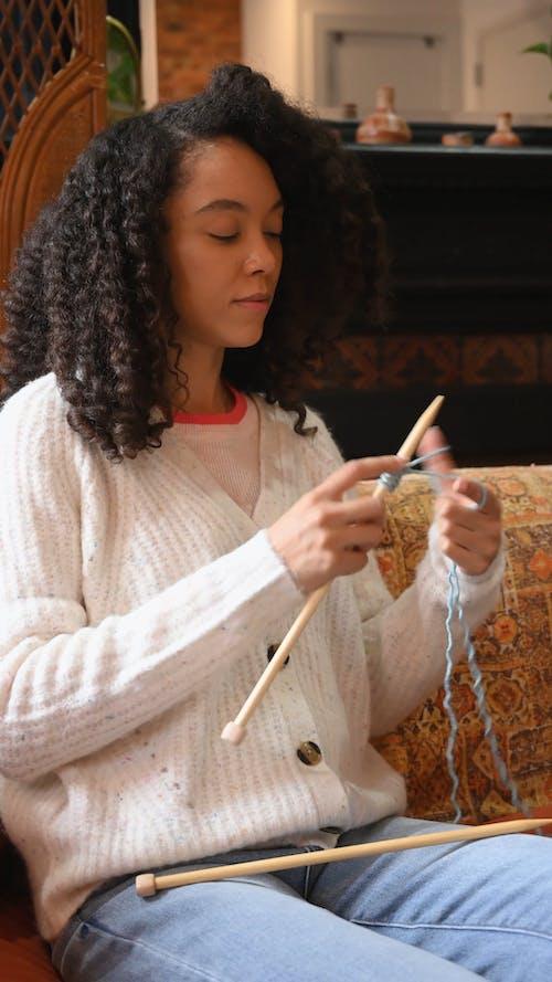 Woman Wearing Sweater Knitting a Yarn