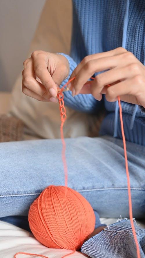 Person Crocheting a Yarn