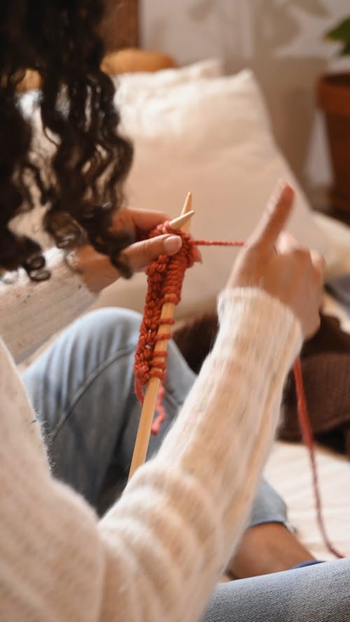 Woman Knitting while Sitting