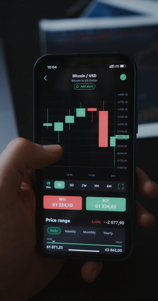 Person Using Smartphone While Looking Bitcoin