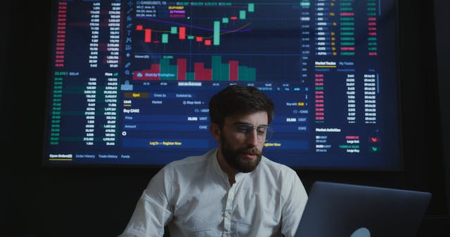 Man Analyzing The Market