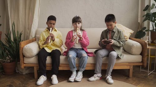 Children Playing Flute Together