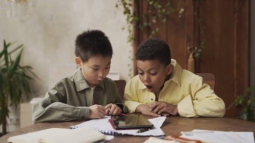 Two Boys using Digital Tablet