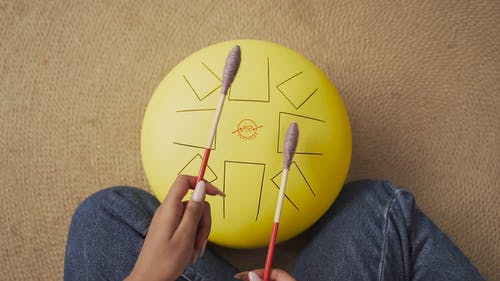 A Person Playing Steel Tongue Drum