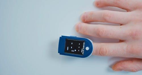 A Person using Pulse Oximeter