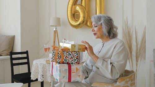 Elderly Woman Celebrating 60th Birthday