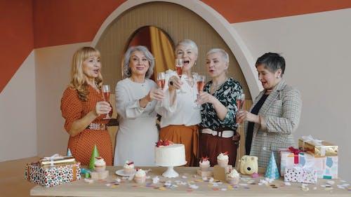 Women Celebrating and Drinking