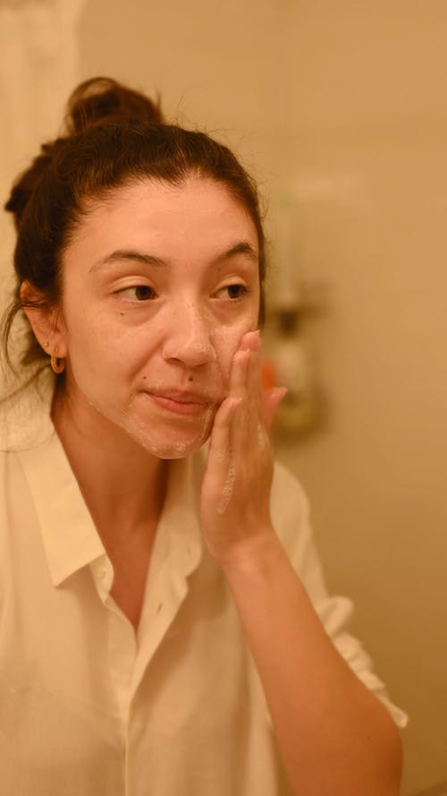 Woman Scrubbing Her Face with Soap