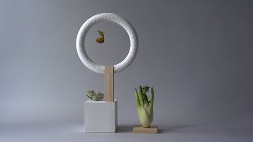Geometric Sculpture With Vegetable on Side
