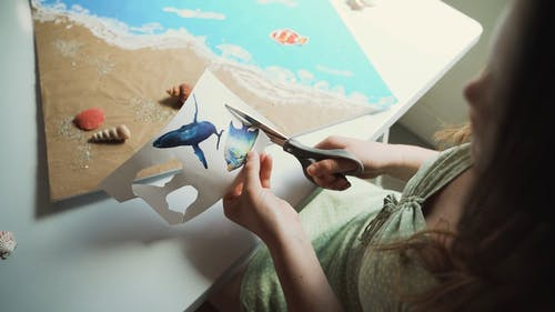 Girl Doing Crafts of the Ocean