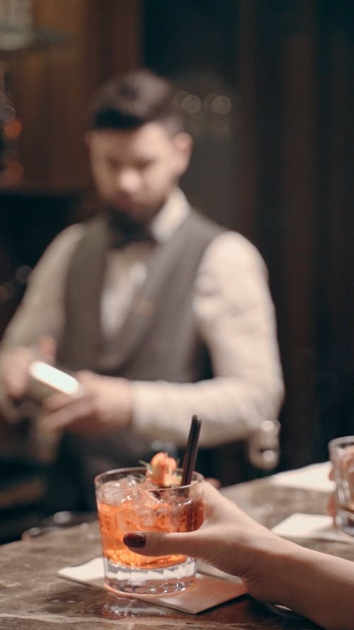 Close-Up Video of a Person Drinking a Cocktail