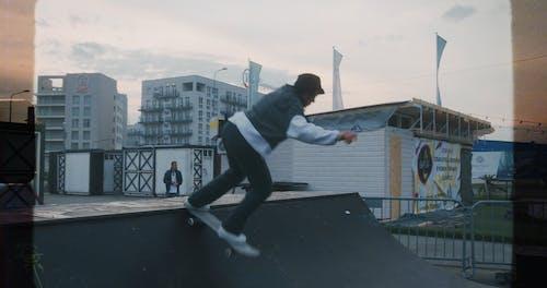 A Girl Skateboarding on a Skate Ramp
