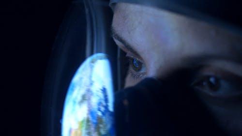 Earth Reflected on Astronaut Helmet