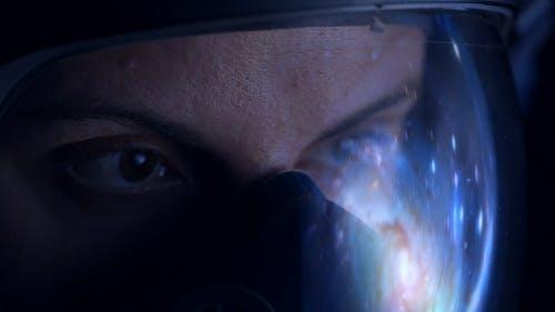 Astronaut Looking at Galaxy